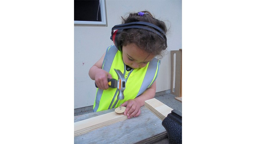 Child doing carpentry at Learning Adventures Levin childcare